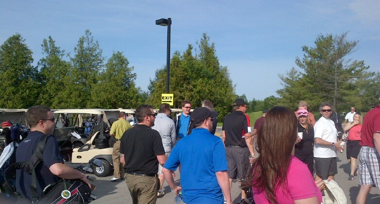 Golfers walking to their carts